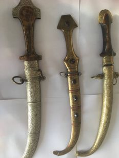 Three Koummya daggers one in silver-plated metal and two in brass, Morocco, Berber - Early 20th century