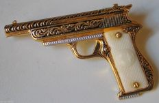 Gold Revolver Brooch, Tolède & Celluloid, (no reserve price) Period 1940s.