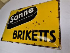 Old enamel sign, Sonne-Briketts, domed shape with glaze and manufacturer