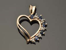 14 kt gold. Pendant with diamonds and sapphires - height 21 mm