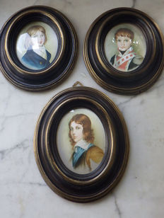 Three portraits on silk in oval wooden frames, 1960-70s