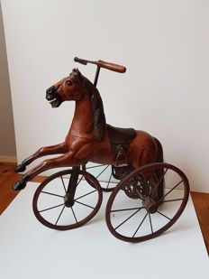 Tricycle in the shape of a horse