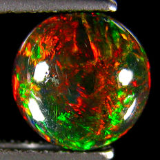 Amazing Fire with Rainbow Flash Black  Opal Round  - 8.02 x4.06 mm - 1.41 Ct