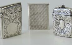 Three HM silver vesta cases, one Chester made and two Birmingham made,