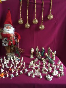 Large Santa Claus, 71 retro wooden Christmas hangers, 11 piece porcelain group of figurines, 5 golden balls