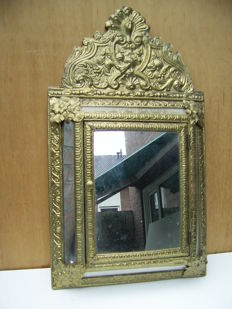 Mirror with wooden frame with richly processed copper fittings