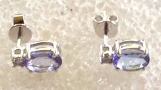 14 kt white gold tanzanite earrings set with a single stone