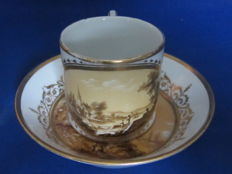 KPM Berlin, Cup and saucer with very fine sepia landscapes, Ca 1800, and a dish with crowned monogram CA 1870