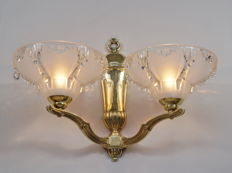 PETITOT & EZAN - A large pair of signed Art Deco double wall sconces -  bronze and moulded glass