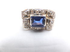 Beautifully made 14 karat bi-colour ring with a blue central stone surrounded by diamonds in old cut. Europe 1st half 20th century.