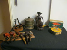 Lot of vintage pipes with an old pipe holder and tobacco box and tobacco