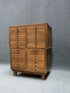Vintage chest of drawers with small vitrine.