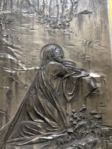 Old metal relief of Jesus
