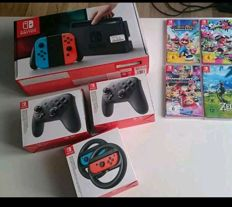 Nintendo switch with 2 controllers , 4 games and more. Games like Mario Kart and Zelda