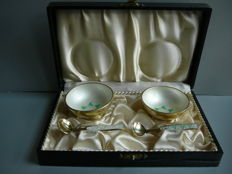 Pair of silver salt cellars, enamelled with green leaf pattern, accompanied by 2 matching salt spoons in case, Denmark, 20th century