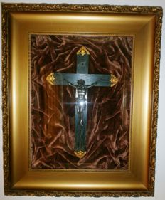 Crucifix plaque behind convex glass