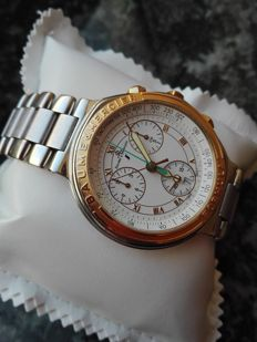 Baume Mercier, Formula S chronograph in 18 kt gold and steel. MV.04.FO.11.2FO from 2001. Men's wristwatch
