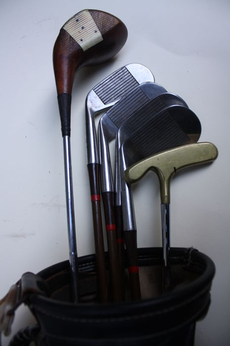 Collectable set of vintage golf clubs ,A rare Brassie wood , 4 England crown Irons, A early Bull's Eye  Putter  in old golf bag
