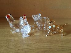 Swarovski - parrot - grizzly cub with fish - hen with red crest - Golden Retriever puppy standing