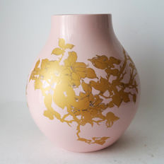 Hella Jongerius for IKEA - PS Jongberg in a pink colour with a gold-coloured flower decoration.
