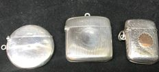 3 Silver vesta cases 1 concave, 1 circular ,1 With 9ct gold cartouche
