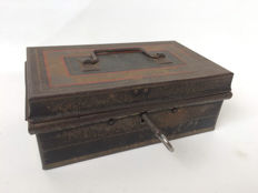 Old iron money box with key