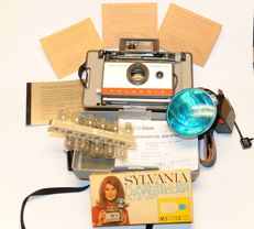 Polaroid automatic Land Model 104 with manual, lamps, etc.