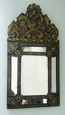 Decorative wooden mirror fitted with brass foil sheets, the Netherlands, first half of the 20th century