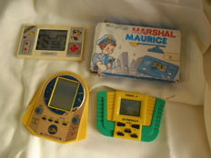 4 Handheld games - Pac Man , Marshal boxed , Astro Destroyers and Tarzan Jr.