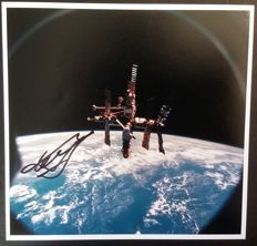 Photography dedicated to the Mir space station - signed by the Cosmonaut Louri Guidzenko