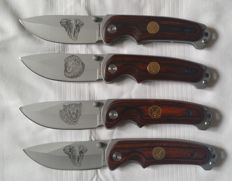 Lot of 4 hunting knives with african wildlife motives on the blade