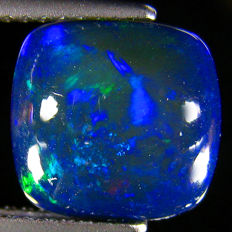 Black  Opal with Blue Flashing  -  9.08 x 9.06 x 4.02 mm  - 2.12 Ct