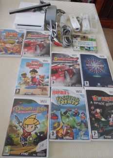 Nintendo Wii including 2 controllers  , 1 nunchuck and 9 games like Worms , Big Beach sports and more