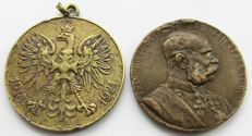 Two medals of Austria and Poland.