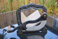 """A heavy cast-iron bread slicer from the brand """"Angela"""""""