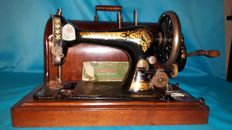 Antique Singer sewing machine complete with case and original Singer box with extra accessories, 1898