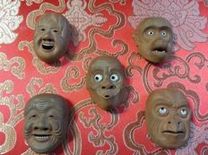 Set of  five ceramic netsuke masks, signed 'Sekiho' - Japan - Late 19th century/early 20th century