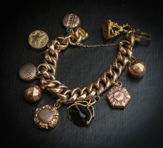 French vintage bracelet with 9 charms in gold tone.