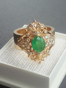 14k Gold Ring with 28 diamands and 1.3ct natural emerald . Size 17.40mm/ 12g