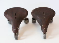 Two nostalgic men's bicycle seats made of leather -Netherlands - around 1940 / 1950