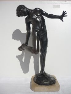 'Young man bitten by a crab' - bronze-patinated  antimony sculpture mounted on a marble base - Italy - first half of the 20th century