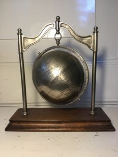 Heavy metal globe on stand