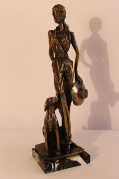 Woman with dog in bronze - Second half of the 20th century