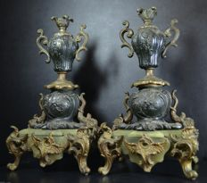 A pair of zamac, bronze and onyx candlesticks, circa 1900