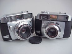 Two vintage metal rangefinder cameras, the Baldessa 1B and the Baldamatic, from the German brand Balda, both from the year 1958