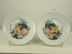 A pair of porcelain plates with two rabbit decor - China - dated 1950
