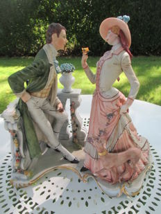 Porcelain sculpture of a couple with a dog, CapodiMonte, signed Fornili Sparta