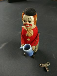 Schuco, Germany - Height: 11 cm - clown with mug, 1930s