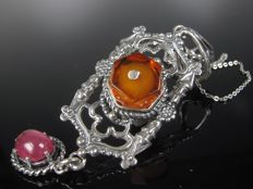Pendant with amber ruby on chain