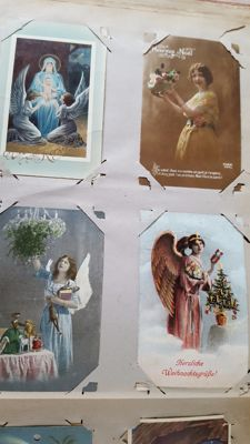 Album containing cards Happy New Year/ Christmas cards, with children, landscapes, clocks etc. 136x